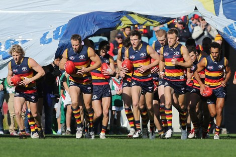 Adelaide run out to face the Cats in Round 17