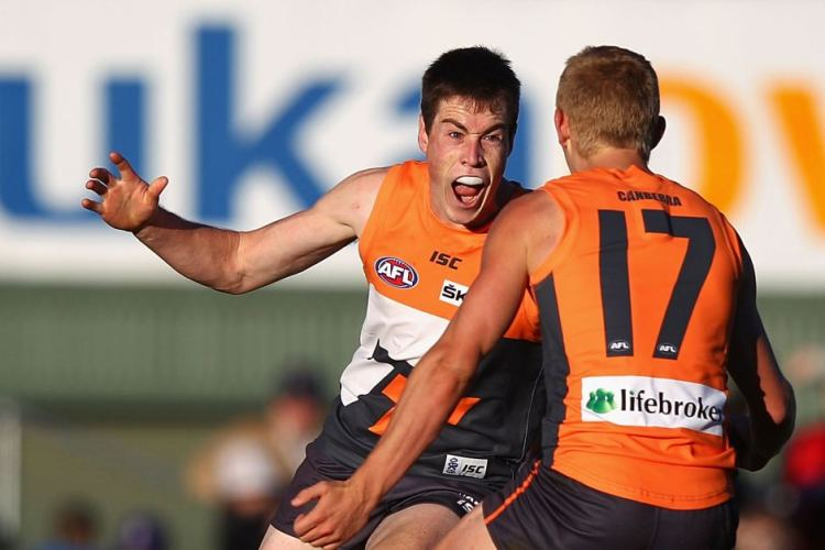 Giants forward Jeremy Cameron celebrates with Adam Treloar.