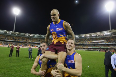 Lion Ash McGrath is chaired off after kicking the game winner after the siren in his 200th game.