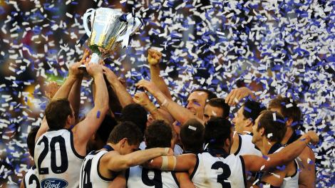 Geelong celebrate winning the 2011 flag